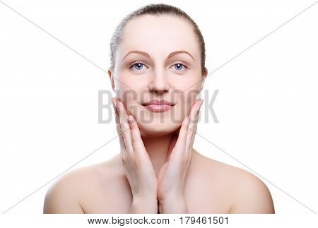 Portrait of a girl with nude make-up with hands on chin isolated on white background. Girl with clean healthy skin on white. Cosmetology spa medicine beauty care.