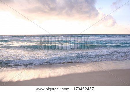 Sunrise in the beautiful sea shore in Cancun Mexico