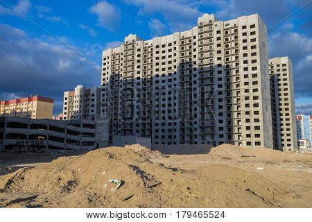 Construction of new multi-storey houses in the wasteland, Voronezh, Russia