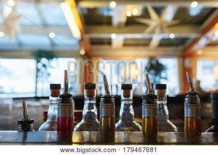 a few bottles on the bar barman prepared for making alcoholic drinks during a party at a nightclub, a restaurant or cafe. bar in a nightclub with a bright backgrounds.