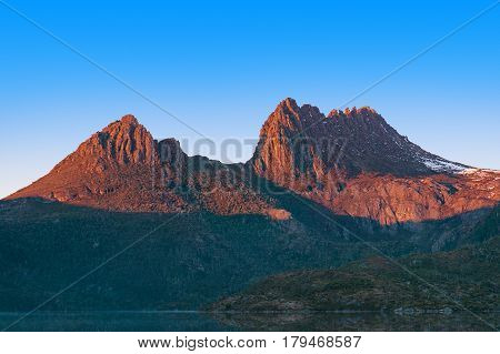 Close Up Of Sunlit Cradle Mountain On Sunrise