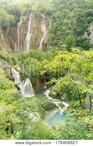 Tourists pack the walkways overlooking the lakes and waterfalls at Plitvice Lakes National Park in Croatia.