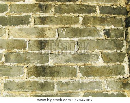 weathered grey brick wall