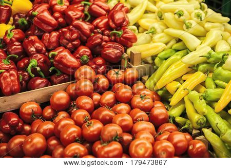 Mix of fresh tomato, peppers and paprika on the farm market. Natural local products on the farm market. Harvesting. Seasonal products. Food. Vegetables.