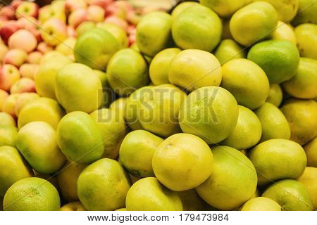 Exotic fruits - sweetie, sweety, pomelo on the farmers market. Products rich in vitamins. Natural local products on the farm market. Harvest. Food.