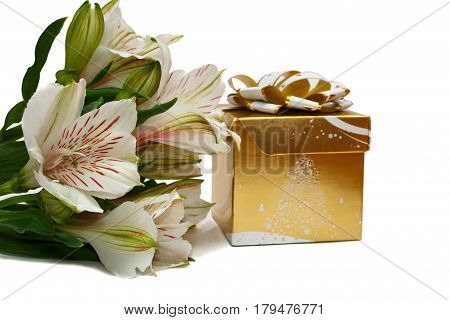 Unwrapped bouquet of alstroemerias with square golden gift box isolated on white with shadows