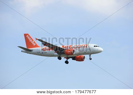 Amsterdam the Netherlands - March 31st 2017: G-EZAB easyJet Airbus A319-111 approaching Polderbaan runway at Schiphol Amsterdam Airport the Netherlands