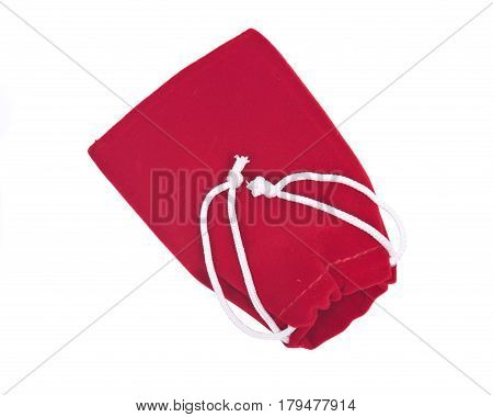 Red velveteen crystal pouch isolated on white background