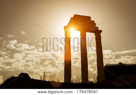 Ruins of the Temple of Castor & Pollux in the Roman Forum at sunset, Rome, Italy