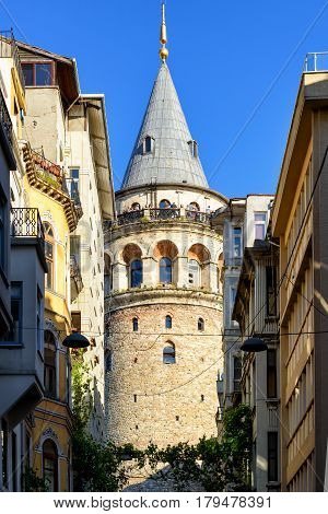 ISTANBUL - MAY 26, 2013: The Galata Tower with tourists on the observation deck. The Galata Tower is the greatest monument of Middle Ages.