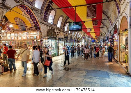 ISTANBUL - MAY 27, 2013: Tourists visiting the Grand Bazaar in Istanbul. The Grand Bazaar is the oldest and the largest covered market in the world with 61 covered streets and over 3000 shops.