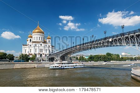 MOSCOW - AUGUST 9, 2013: The Cathedral of Christ the Saviour and Patriarshy bridge in Moscow. It is the tallest Orthodox Christian church in the world.