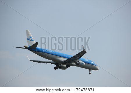 Amsterdam the Netherlands - March 31st 2017: PH-EXB KLM Cityhopper Embraer ERJ-190STD approaching Polderbaan runway at Schiphol Amsterdam Airport the Netherlands