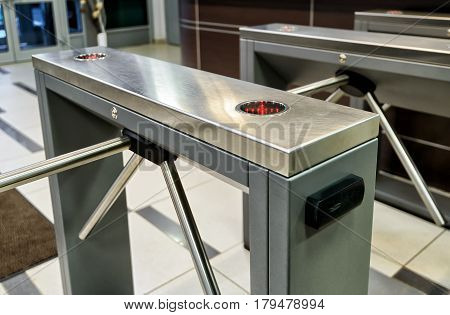 The tripod turnstile with electronic card reader is closed