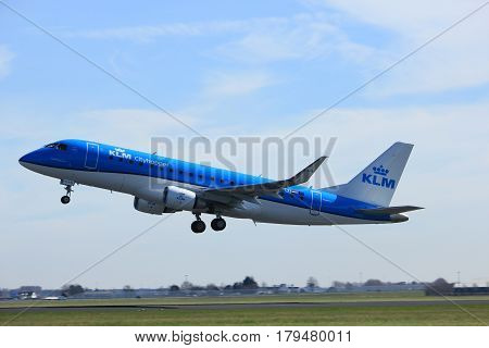 Amsterdam the Netherlands - March 25th 2017: PH-EXI KLM Cityhopper Embraer ERJ-175 takeoff from Polderbaan runway.