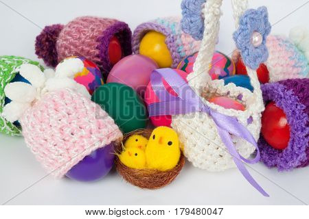 colorful knitted caps and baskets for Easter