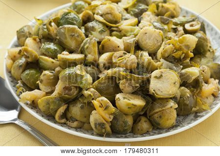 Moroccan dish with Brussels sprouts and preserved lemon close up