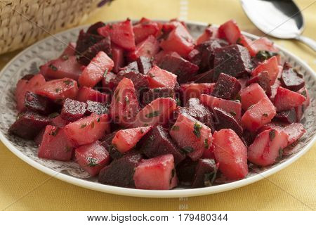 Dish with Moroccan salad with beets and potatoes close up