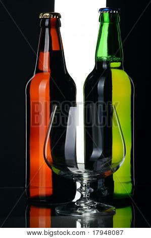 Bottles Of Beer From Green And Brown Glass, Isolated.