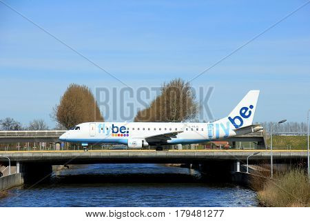 Amsterdam the Netherlands - March 25th 2017: G-FBJG Flybe Embraer ERJ-175 taxiing to takeoff from Polderbaan runway.