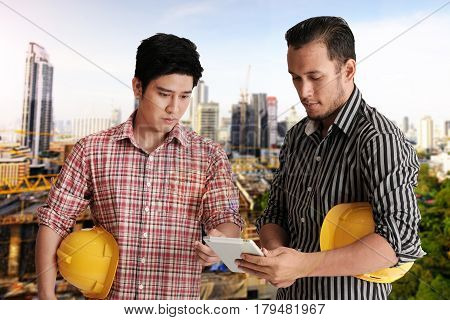 Two Engineer Discussing Project
