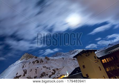 Winter Ski resort Tignes by night. Clouds and star in the long exposure