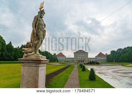 Statue Pluto In The Baroque Garden Of The Nymphenburg Palace.