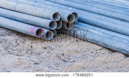 Close up of metal pipes that are used to build scaffolding at construction site