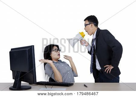 Image of boss shouting at his employee through megaphone while standing in the studio