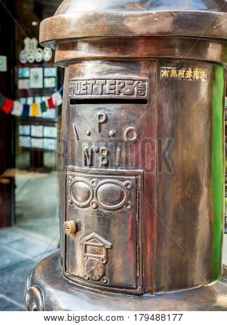 Tianjin, China - Nov 1, 2016: Stylish bronze letterbox along the Tianjin Ancient Cultural Street (Guwenhua Jie). This is a very popular tourist area.