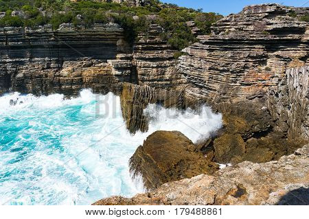 Mountain Cliff And Powerful Ocean Waves