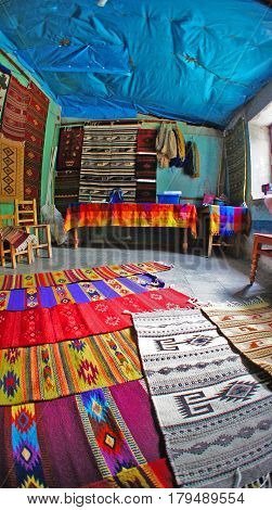 A local store sell tapetes(rugs, carpets) in Teotitlan del Valle city, Oaxaca, Mexico. It is famous for tapetes (rugs) that are woven on hand-operated looms from locally-produced wool and dyes.