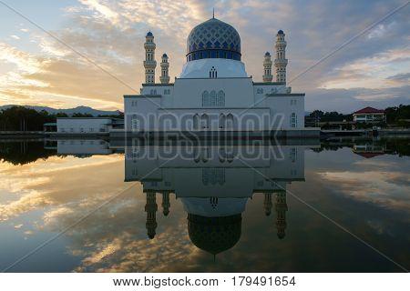 Reflection of Kota Kinabalu city mosque during sunrise located at Sabah, Malaysia