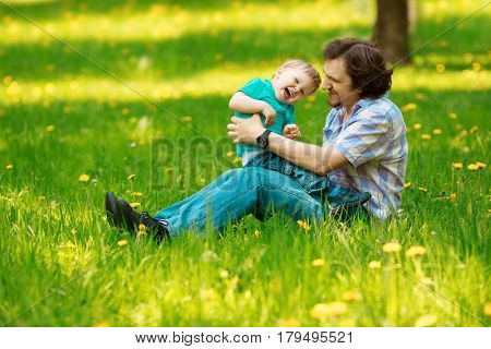 Father and son spending time together on a sunny day. Happy little boy having fun with dad. Walking, having quality family time together on vacation.  Positive family on travel.
