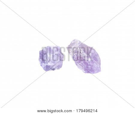 Natural amethyst chunks from Madagascar isolated on white background