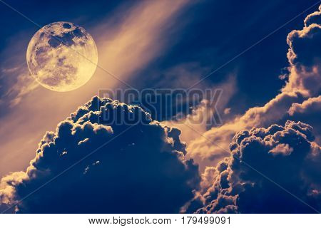 Super moon. Attractive photo of background night sky with cloudy and bright full moon. Nightly sky with beautiful full moon. Vintage tone effect. The moon were NOT furnished by NASA.