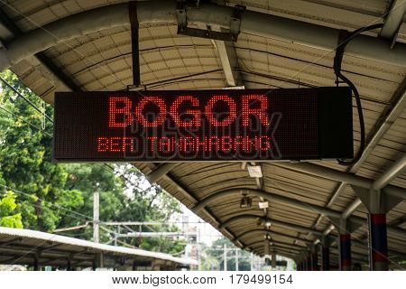 Display monitor at train station showing train to Bogor will entering station soon photo taken in Jakart Indonesia java