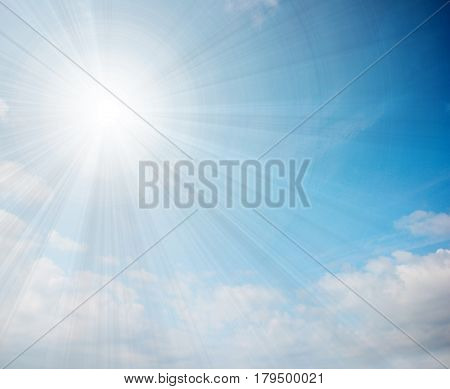 Sunny bright piercing rays and streams of light on a cloudy sky