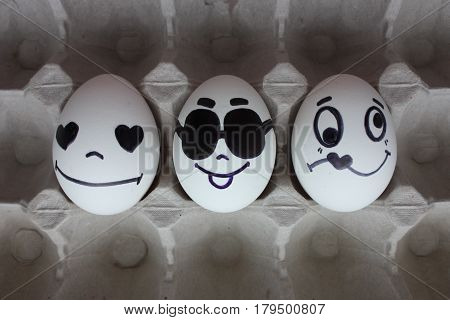 Eggs With Faces Photo For Your Design. In The Box