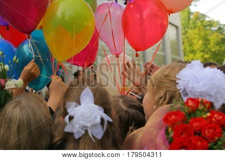bright balloons on the first day of school
