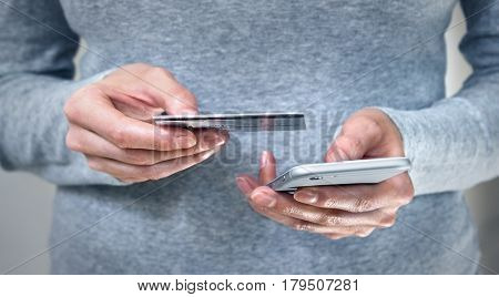 Woman hand on mobile phone and credit card for online shopping