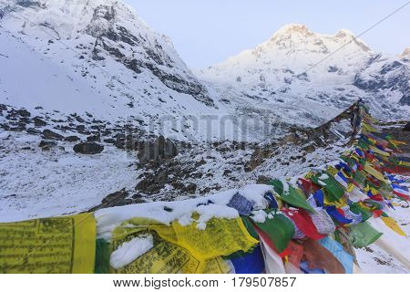 ANNAPURNA, NEPAL -  APRIL 14, 2016 :Prayer flags and snow mountain of Himalaya Annapurna base camp with Annapurna south peak in background Nepal
