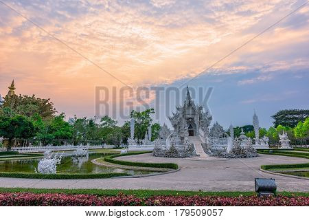 Wat Rong Khun(White temple)at sunset in Chiang Rai,Thailand.02/04/2017 Wat Rong Khun is modern building, well known worldwide.It was  designed by  Chalermchai Kositpipat.Opened it to visitors in 1997.