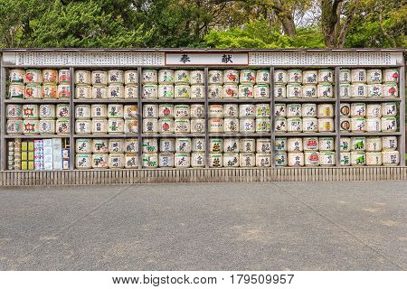 KAMAKURA JAPAN - APRIL 14 2014: Stack of Japanese wine (sake) barrels at a shrine on April 14 2014 in Kamakura Japan. Japanese donate wine to the temples and shrines as offering for the Gods.
