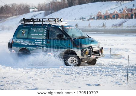 KHABAROVSK RUSSIA - JANUARY 28 2017: Mitsubishi Delica riding on snow during local championship