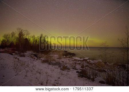 Aurora borealis over Ladoga Lake on the March night. Pyatirechye, Leningrad region. Russia