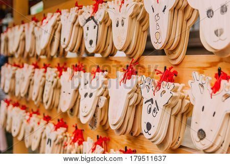 Wooden prayer tablets in Kasuga-taisha shrine in Nara. Wooden prayer tablets in Nara are uniquely design as a deer which is considered divine and sacred.