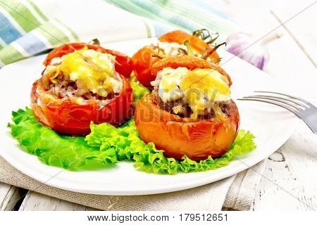 Tomatoes Stuffed With Rice And Meat In Plate On Light Board