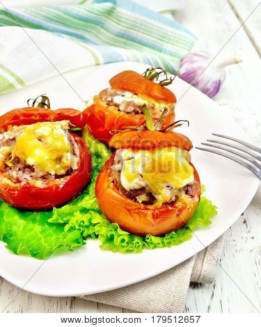 Tomatoes Stuffed With Rice And Meat With Lettuce In Plate On Light Board