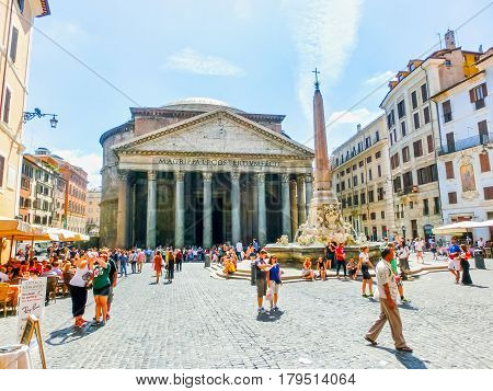 Rome, Italy - September 10, 2015: The people walking near Panteon - the temple of all Gods in Rome. Panteon is famous monument of ancient Roman culture, built in the 2nd century.